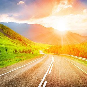 Open road with mountain sunrise view